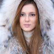 Beautiful young womin winter fur coat — Stock Photo #1913890
