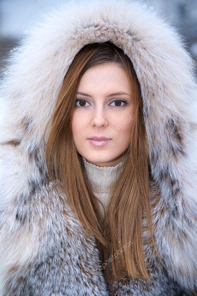 Beautiful young woman in winter fur coat — Stock Photo © Sergios
