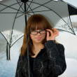 Beautiful woman under umbrella — Stock Photo