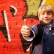 Kid standing in front of graffiti wall — Stock Photo #1996535