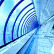 Glass corridor in modern business centre - Stock Photo