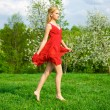 Young beautiful woman in a red dress — Stock Photo