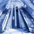 Royalty-Free Stock Photo: Standing on escalator in modern b