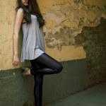 Young beautiful female model standing ne — Stock Photo