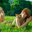 Young beautiful womlying on grass — Stock Photo #2002397