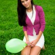 Beautiful girl holding balloon — Stock Photo