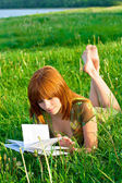Young beautiful girl reading a book — Stock Photo
