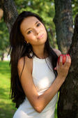 Beautiful young women holding apple in t — Stock Photo