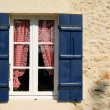 Blue Shuttered Window - Stock Photo