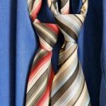 Necktie on blue background — Stock Photo #1760505