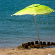 Parasol on the beach — Stock Photo