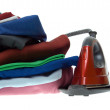Stock Photo: Isolated steam iron and stack shirts