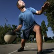 Stock Photo: Man play basketball