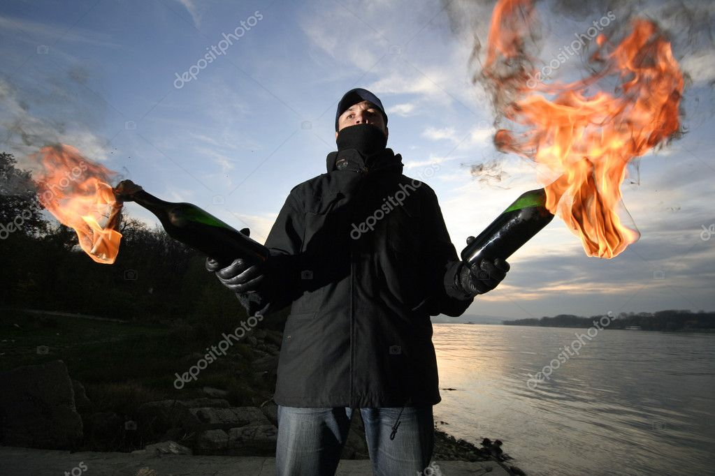 Young man with a Molotov cocktail — Stock Photo #1750590