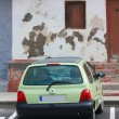 A car parked in front of vintage house — Stock Photo #1696610