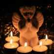 Christmas angel and votive lights - Stockfoto
