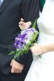 Bride holding wedding bouquet — Stock Photo