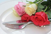 Roses and cutlery — Stock Photo
