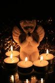 Christmas angel and votive lights — Stock Photo