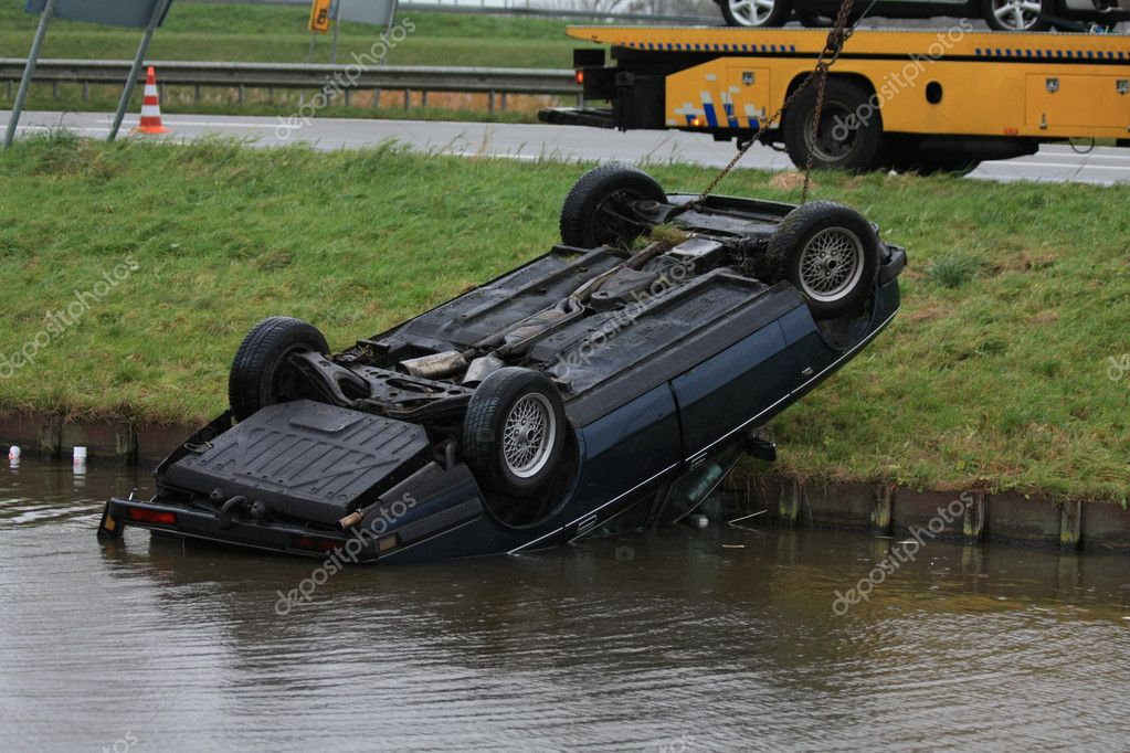 Car lands in water after an accident — Stock Photo #1697736