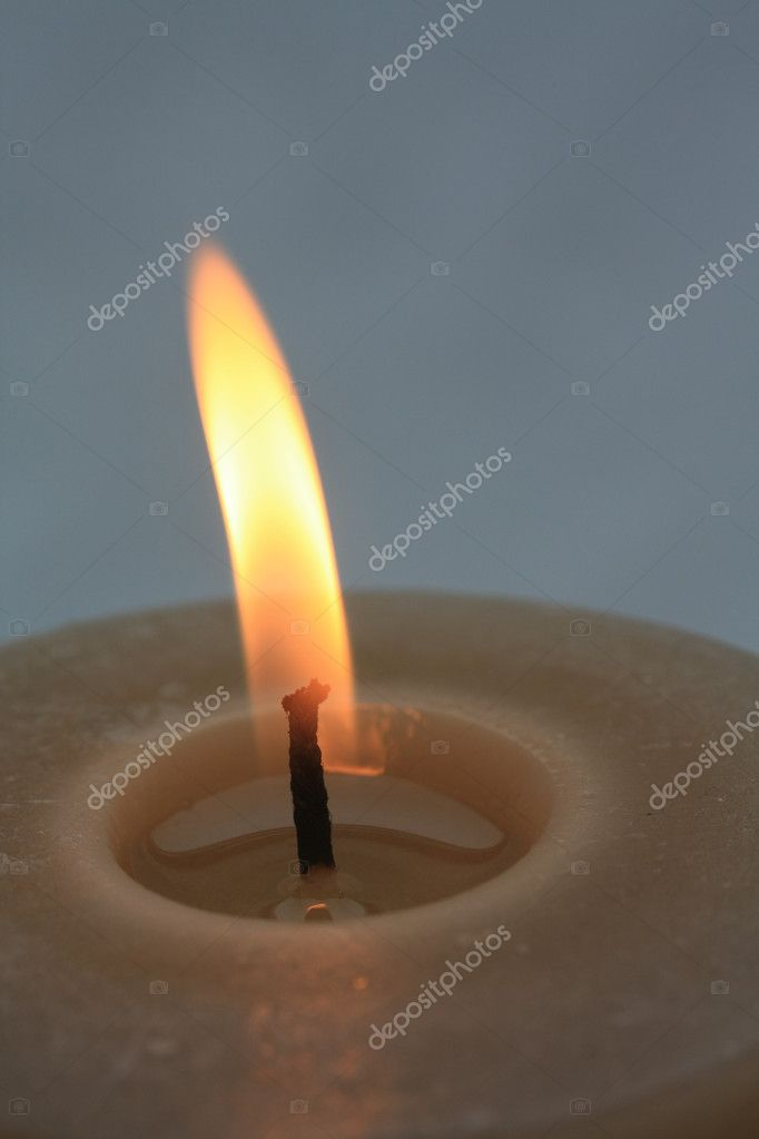 Close up of a beige burning candle — Stock Photo #1699465