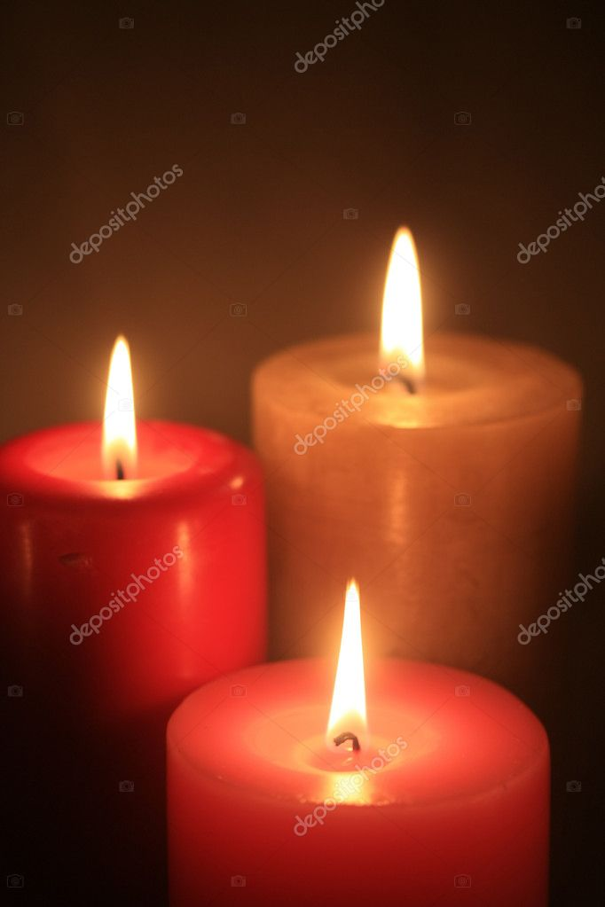 Three burning candles in a group  Stock Photo #1699861