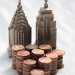 Stacks of coins fiancial skyline — Stock Photo