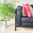 Interior design: black leather sofa — Stock Photo