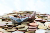 Boat on a money sea — Stock Photo
