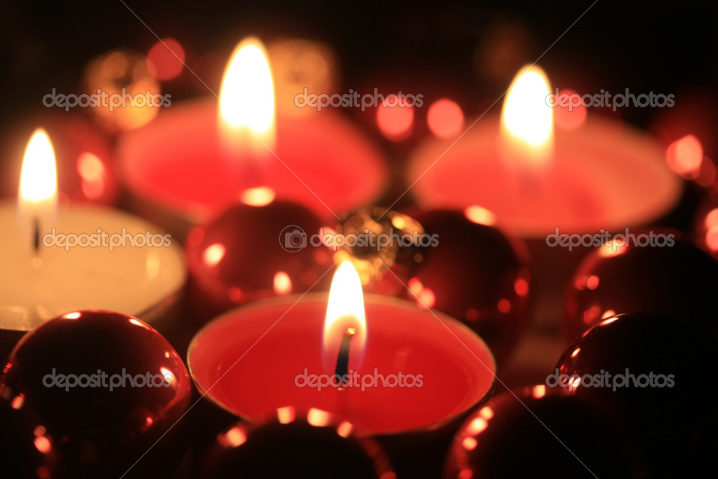 Small burning votive lights and christmas decoration  Stock Photo #1700872