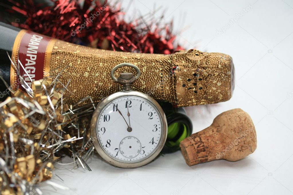 A champagne bottle and a vintage watch, counting down to twelve  Stock Photo #1701152