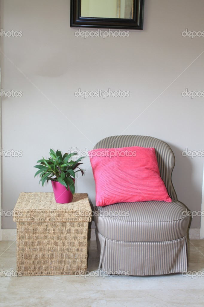 Nterior design: Classic Biedermeier chair and wicker footstool, pink accessoiries — Stock Photo #1707702