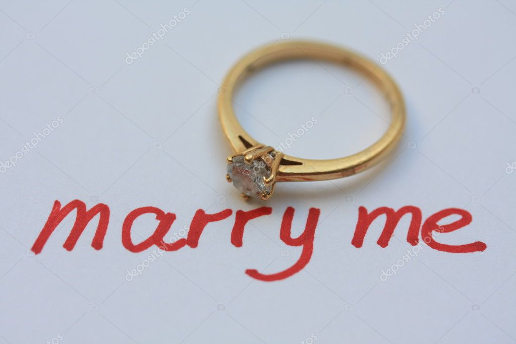 Written proposal with solitaire engagement ring — Stock Photo #1708708