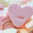 Diamond ring and candy hearts — Stock Photo