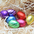 Chocolate eggs in a nest — Stock Photo