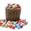Stock Photo: Wicker basket with chocolate eggs