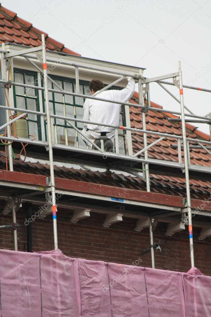 A painter working on a covered scaffolding — Stock Photo #2613164