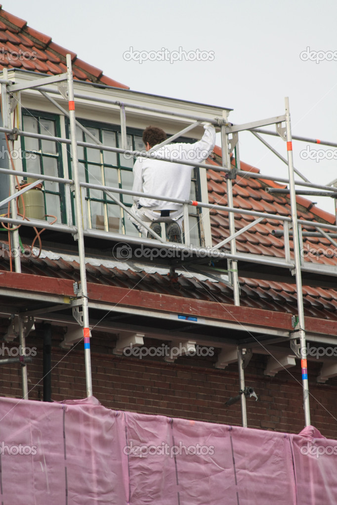 Painter at work on scaffold — Stock Photo © portosabbia #2613164