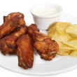 Fried chiken wings with chips — Stock Photo