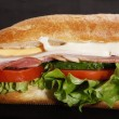 Постер, плакат: Ham submarin sandwich closeup