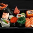 Mix japanese rolls and sushi assorti — Stock Photo
