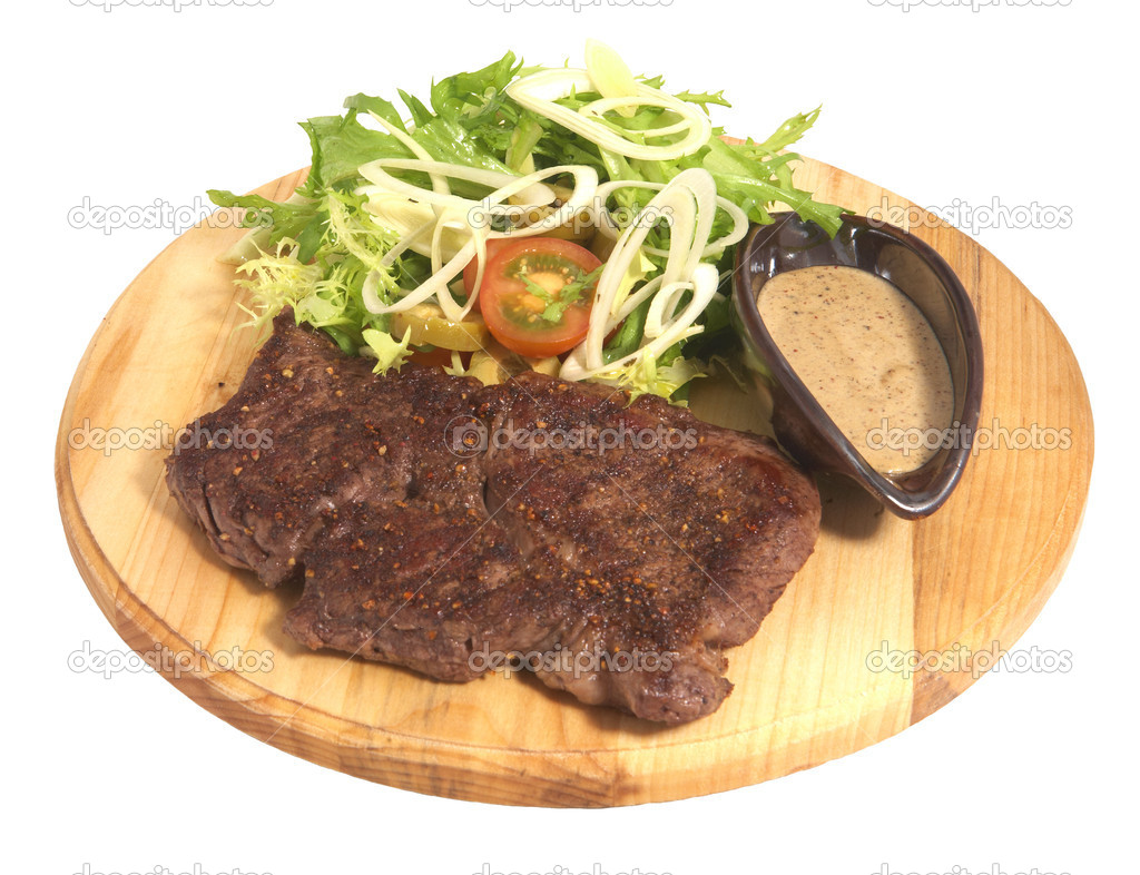 Beef steak with salad and souce on wood plate isolated on white background  Stock Photo #1651276