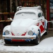 Old car in snow — Stock Photo