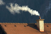Roof and smoke — Stock Photo