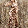 Стоковое фото: Young woman on the autumn field