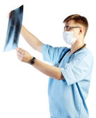 Doctor looking to x-ray image — Stock Photo