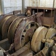 Stockfoto: Abandoned big pulley mine.