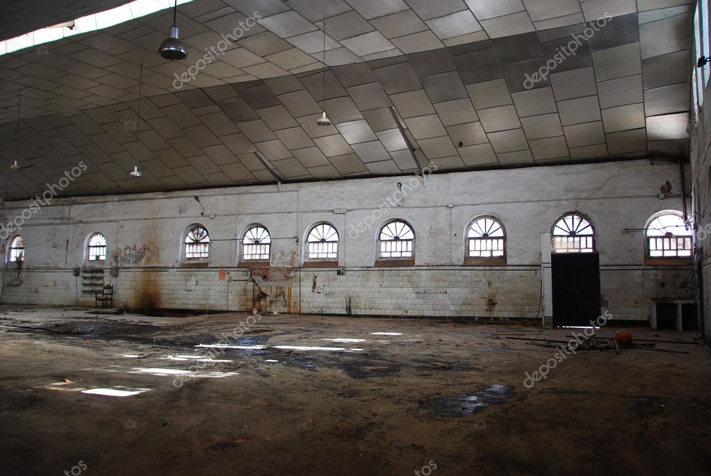 Deserted factory - Abandoned empty warehouse.  Stock Photo #1695351