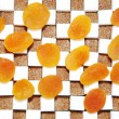 Cubes of sugar and dry apricots — Stock Photo