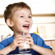 Foto Stock: Happy boy with milk